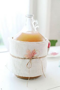 Ugly label on a beautiful cider jug? Just wrap it with linen towels and secure with some twine. Instant fall.