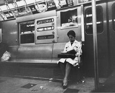 A woman rides the subway at night on the Brighton Beach line in Brooklyn on June 1, 1964.