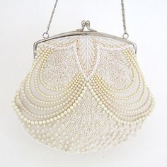 Beaded pearl bridal handbag. Ivory pearl beaded purse designed by Moyna. Find your bridal style at Perfect Details. https://perfectdetails.com/BG2349.htm