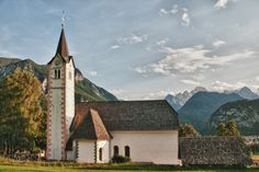 This Parish Church was built in the 14th Century. It displays  several architectural styles, from the gothicperiod onwards. In  1829 the church was rebuilt in neo-renaissance style. On the sacristy wall is a well preserved wall painting (fresco) of the Crucifixion. Many Triglav mountaineers from all over Europe are buried in the churchyard. The priest, Jakob Aljaz worked here and he is a well -known local pioneer in the history of Slovenian Mountaineering.