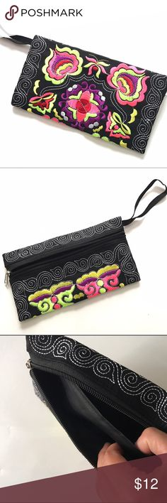 """New Black Handmade Embroidered Wristlet New Black Handmade Embroidered Wristlet measures 4.5"""" x 8.5"""" with black 2 pocket lining and front zipper closure.   Bag is handmade but machine embroidered and brand new from manufacturer.  Bag color is consistent, design and embroidered colors may vary slightly from pictures shown.  Perfect for night out or day Purse or a makeup bag or pencil case.  Multiple colors listed. Great gift idea! Handmade Bags Clutches & Wristlets"""