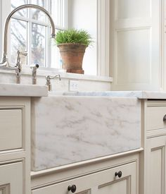 White kitchen with marble apron front sink and bridge faucet Kitchen Redo, Kitchen And Bath, New Kitchen, Kitchen Sinks, Kitchen Ideas, Apron Sink Kitchen, Kitchen Cabinets, Home Staging, Cream Cabinets