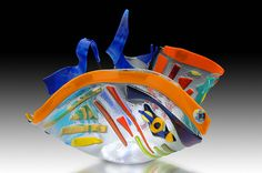 JOSEPHINA ESPINOSA...In the 1980's she became fascinated with fusion glass.  Exited by the artistic possibilities of this medium, she is now using these techniques full-time; always taking forms from nature, bright colours and letting the subconscious mind lead the way. Her works have been exhibited in Southwest Florida and in private collections all over the world.      Other than stained and fusion glass she has studied flower design, china painting and landscape design.