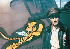 AVG squadron flight leader Robert 'R.' Smith standing next to his Warhawk fighter, Kunming, China, 23 May note Nationalist Chinese emblem on cap and 'Flying Tigers' emblem on aircraft Source United States Air Force Volunteer Groups, Kunming, Sr1, Air And Space Museum, Walt Disney Company, Nose Art, Fighter Aircraft, Heritage Site, Military History