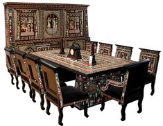 Egyptian Revival, Art Deco Dining Set. Two-tier six-door cabinet, dining table and ten chairs, all inlaid with mythological scenes and hieroglyphs. Wood, ivory and mother of pearl. Antiquarian Traders, 2013.