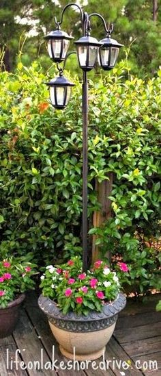 DIY Solar Light Lamp Post with Flower Planter Life on Lakeshore Drive. - DIY Solar Light Lamp Post with Flower Planter Life on Lakeshore Drive. I like this idea for the f - Diy Solar, Solar Lamp, Solar Chandelier, Landscape Lighting, Outdoor Lighting, Lighting Ideas, Driveway Lighting, Backyard Lighting, Outdoor Shade