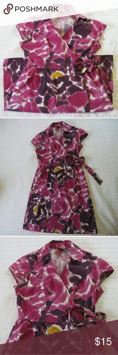 Merona Purple, Pink, and Yellow Floral Wrap Dress True wrap dress with large print purple and yellow flowers. Short sleeves and a collar. Approximately 35'' length, 17'' armpit to armpit. The tie is at the natural waist. Great condition. Merona Dresses