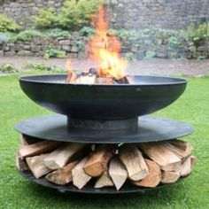 Large ring of logs fire pit for outdoor use. The large metal fire pit for use in the garden or as a camp fire. Circular outdoor fire pit with log store beneath. This camping fire pit is a real focal point. Camping Fire Pit, Fire Pit Backyard, Log Fires, Wood Burning Fires, Metal Fire Pit, Fire Pits, Large Fire Pit, Outdoor Fire, Outdoor Decor