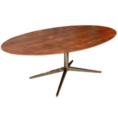 Florence Knoll Rosewood and Chromed Steel Oval Dining Table | From a unique collection of antique and modern dining room tables at https://www.1stdibs.com/furniture/tables/dining-room-tables/