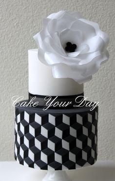 - Black&White Wedding Cake Black & White Wedding Cake. Geometric shapes and waffer paper rose. Zwart & Wit bruidstaart met geometrische vormen en roos van ouwel.