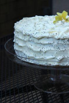Lemon Poppyseed cake filled with homemade lemon curd and lemon cream cheese frosting #cake #dessert #lemon