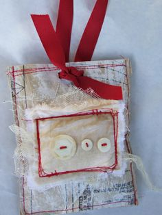 Untitled |textiles trim lace string buttons stamps lace etc top-stitched compiled to become mailart -tag