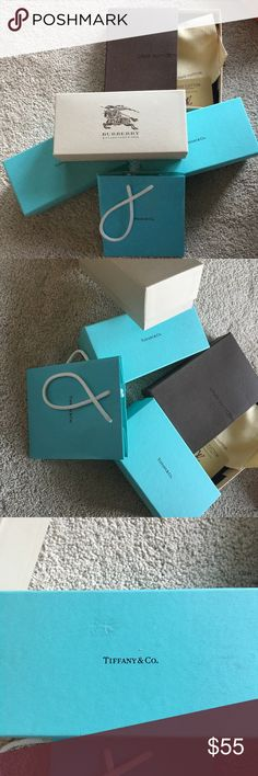 LOT of boxes, etc. Three pairs of sun case boxes (Burberry and to Tiffany and Co) and a cell phone box with dust bag and card (Louis Vuitton) along with a Tiffany and Co. gift bag.  As pictured the Louis Vuitton box is a little bit bent and one of the Tiffany boxes has some markings on the top. Louis Vuitton Accessories