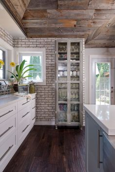 Whitewashed Brick and Reclaimed Barn Wood Shiplap Interiors , IKEA glass front cabinet, gorgeous ceiling by candice