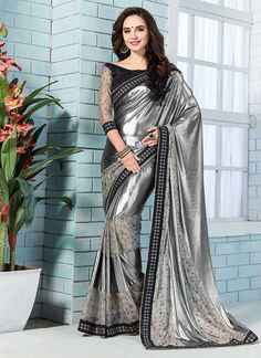 Design and style and trend will be at the peak of your attractiveness when you dresses this grey net and shimmer georgette classic designer saree. The amazing dress creates a dramatic canvas with patc. Trendy Sarees, Stylish Sarees, Fancy Sarees, Saree Designs Party Wear, Party Wear Sarees, Bollywood Designer Sarees, Latest Designer Sarees, Hanfu, Cheongsam