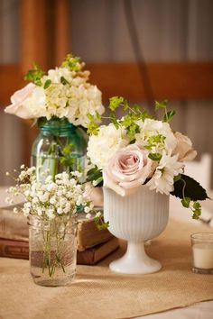 small clusters of flowers in vases