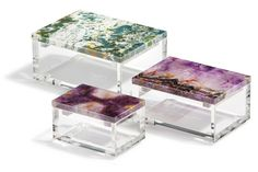 Adorado lidded boxes pair luminous, modern Lucite with hand-carved amethyst stone. These boxes bring a touch of modern luxury to the home. Small: x Medium: x x Large: x x