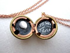 To The Moon and Back Locket. Cheesy but cute.