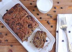 The BEST banana bread made with coconut oil, greek yogurt and a secret ingredient for a moist bread with a rich flavor!