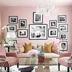living rooms - Ralph Lauren - Early Morning - pink walls black white art gallery tan slipcover sofa pink yellow pillows pink chairs art deco coffee table