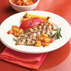 Garlic-Herb Chicken With Peach Relish...moist and tender chicken served with a delicious peach relish.
