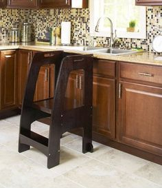 The Espresso Step-Up Kitchen Helper is a sturdy step stool designed to safely and securely elevate children to countertop height. With a better view and easier access, they can be involved in daily ac Learning Tower, Tower Garden, Kitchen Helper, Homemade Christmas, Christmas Ideas, Chair Backs, Wood Projects, Countertops, New Homes
