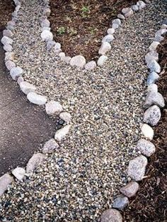 Inexpensive gravel walkway - line with landscape fabric, border with stones and fill with pea gravel. by georgia