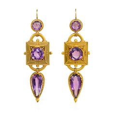 A pair of antique gold and amethyst pendant earrings in the Etruscan style, the circular amethyst tops suspending square-shaped gold plaques with amethyst centers and applied bead and wirework, terminating in teardrop-shaped amethyst pendants, in 15k.  Circa 1870