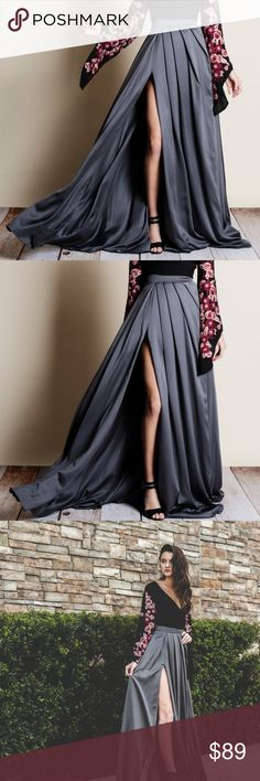 ✈️ COMING SOON! Luxurious Satin Maxi Skirt! Slip into this GORGEOUS head turning flowing satin maxi skirt with side slit and high waistband, it has a zipper closure and pleats that drapes from the waist. Sizes are true to fit. Skirts Maxi