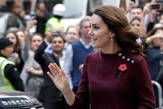 Kate Middleton Photos - Britain's Catherine, Duchess of Cambridge and patron of national children's mental health charity Place2Be, greets onlookers on her arrival at the annual Place2Be School Leaders Forum in London on November 8, 2017. / AFP PHOTO / POOL / John Phillips - The Duchess Of Cambridge Attends Place2Be School Leaders Forum