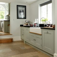 Sage green cupboards and butler sink