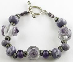 Purple dots on clear glass.  Lampwork glass bead bracelet