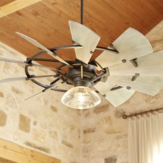 Blades finished in light weathered oak spin around a framework of oiled bronze in the mesmerizing farmhouse style Windmill ceiling fan from Quorum International. #WindmillFans #UniqueCeilingFans #RusticCeilingFan #FarmhouseFanCeilings #CeilingFanIdeas