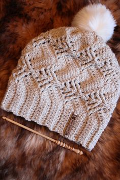 Pinetree Hat pattern by Viktoria Gogolak Inspired by the Nevron hat, this hat is worked in rows sideways. A little bit of lacy, a little bit of wintery at the same time. Front post stitches create cute little pinetrees on your hat 🙂 Crochet Adult Hat, Crochet Hat For Women, Crochet Beanie Hat, Knit Or Crochet, Cute Crochet, Crochet Scarves, Crochet Crafts, Crochet Clothes, Crochet Projects