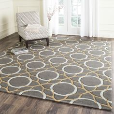 Safavieh Hand-Hooked Four Seasons / Ivory Polyester Rug