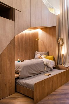In this modern kids room, a pull-out trundle bed is hidden beneath the main bed for when guests stay over. Modern Kids Bedroom, Kids Bedroom Designs, Kids Room Design, Home Decor Bedroom, Bedroom Ideas, Bedroom Fun, Kid Bedrooms, Bedroom For Kids, Girls Bedroom