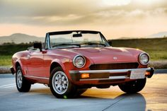 Over the years the many models built by Fabbrica Italiana Automobili Torino (FIAT) have been desi… David Knawa needs your support for National Fiat Spider Day Fiat 124 Sport Spider, Fiat 124 Spider, Evil Under The Sun, Fiat Abarth, Exotic Sports Cars, Sport Cars, Over The Years, Vintage Cars, Classic Cars