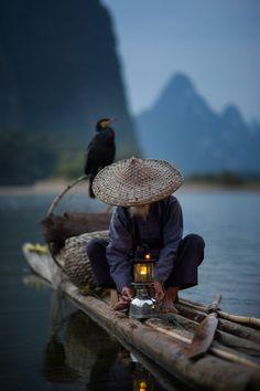 Cormorant Fisherman V - Cormorant Fisherman on the Li River in Xingping, China.