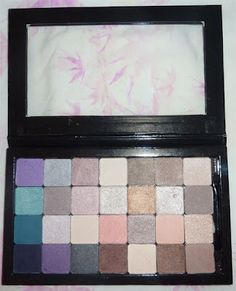 Z Palette that has Depotted Elf Eyeshadows..love it!! =)