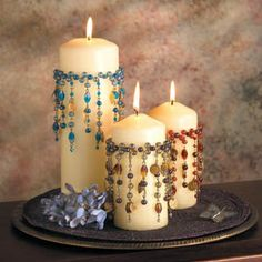Beaded candles - very boho - inspiration only - would probably apply these to the glass, since dripping wax would ruin a lot of work otherwise! Make collars, pin to candles, to burn, put rubber band around candle jar