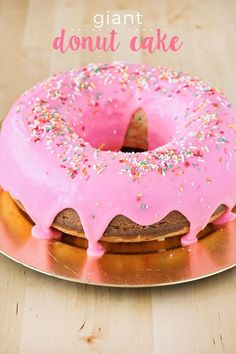 This giant donut cake is super easy to make, and so fun, too! Perfect for birthdays and special occasions! This giant donut cake is super easy to make, and so fun, too! Perfect for birthdays and special occasions! Donut Party, Donut Birthday Parties, Birthday Cake Girls, Donut Birthday Cakes, Easy Kids Birthday Cakes, Easy Cakes For Kids, Birthday Ideas, Cupcake Birthday Cake, 16th Birthday