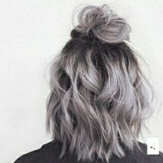 Grey silver short curly hair with half up half down.