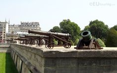 This photo shows a row of military and historical cannons lined up on the wall to the entrance of Les Invalides.  Daily updates at www.eutouring.com/images_les_invalides.html