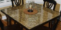 Wine cork table top with a glass overlay%u2026seems like the perfect idea for a bar table.