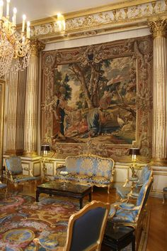 The period this image belongs to is the Baroque era. The use of bold colours, demask furnishings as well as the putti images on the walls and marquetry patterned flooring are all key elements used in this era.