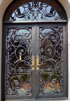 Wrought iron doors are indeed a style from the past. With creativity, you can make your house look more sophisticated with the wrought iron front doors. Double Door Design, Front Door Design, Cool Doors, Unique Doors, Iron Front Door, Front Doors, Front Entry, Home Modern, Wrought Iron Doors