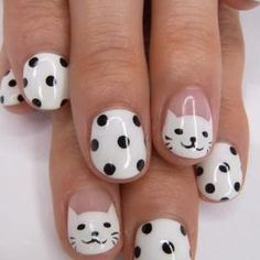 Black and white nails with cat faces. So cute!