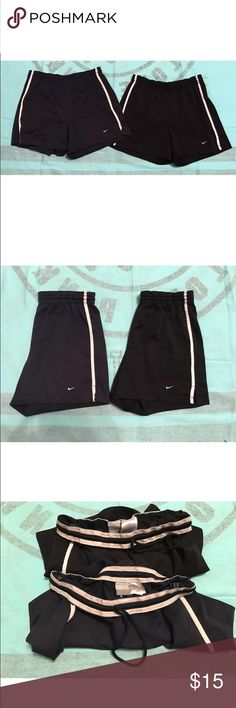 """Set of 2 Nike athletic shorts in excellent condition. one is navy and one is black. comes from a smoke free, pet friendly home. 🚫NO TRADES!  measurements: top to bottom: 14"""" , inseam: 4"""" Nike Shorts"""