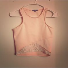 Light Pink Crop Top Excellent condition. Size: Medium... Has a small stein in the front but it's not noticeable. It has lace on the bottom. Charlotte Russe Tops Crop Tops