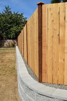 We like the clean lines of this privacy fence and retaining wall. The wall was built with neutral style Basalite Encore bricks and matching capstones. Cedar Wood Fence, Rustic Fence, Concrete Fence, Brick Fence, Retaining Wall Fence, Wood Privacy Fence, Small Retaining Wall, Modern Fountain, Fountain Design